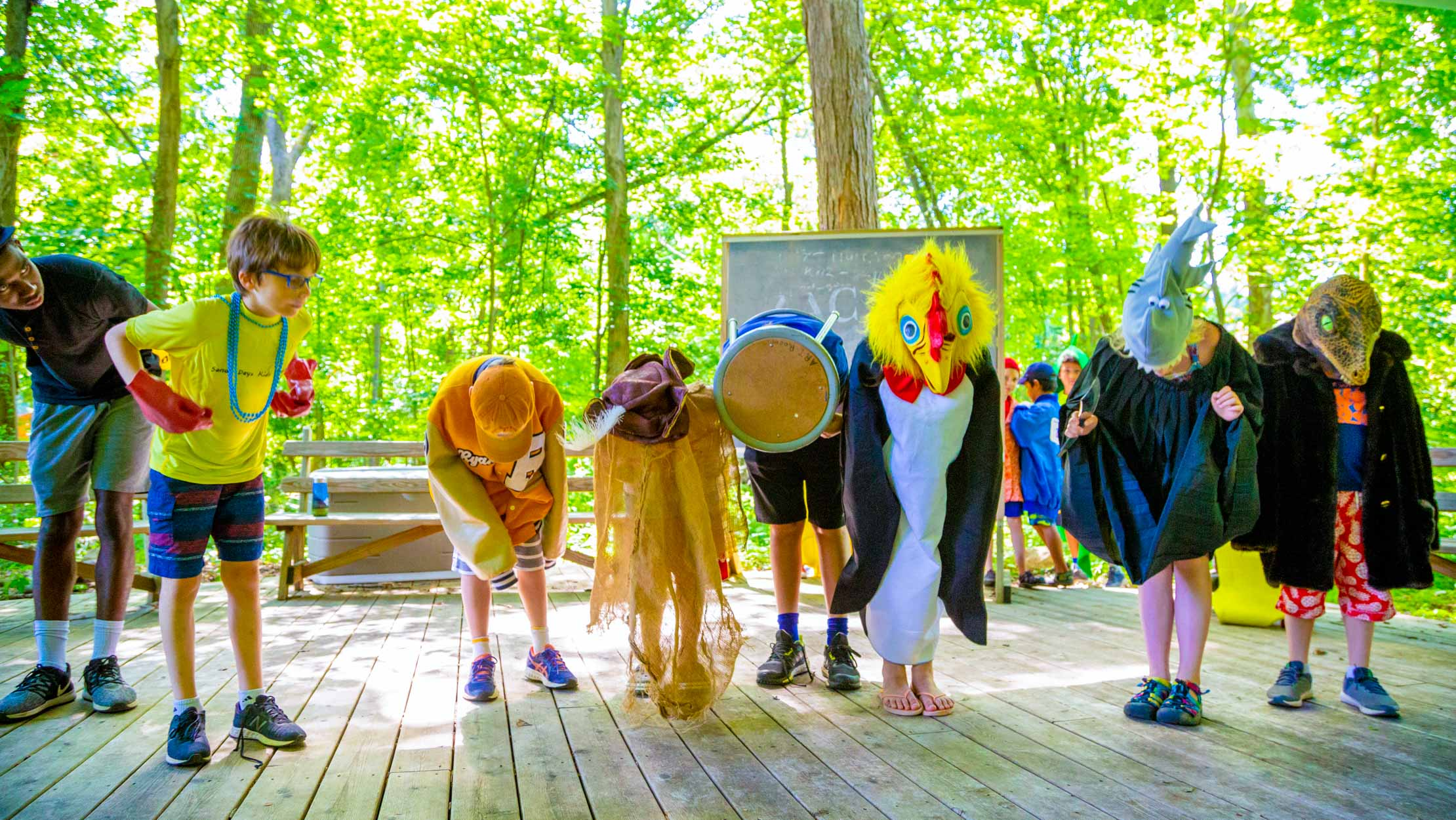 Campers in costume bowing after a skit