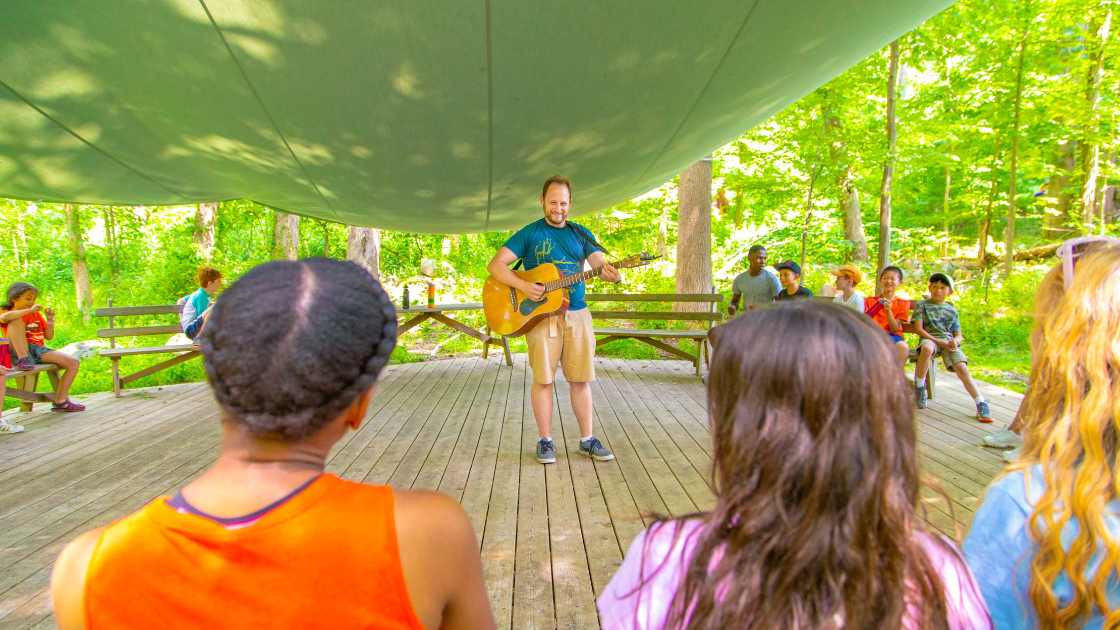 Music teacher playing guitar