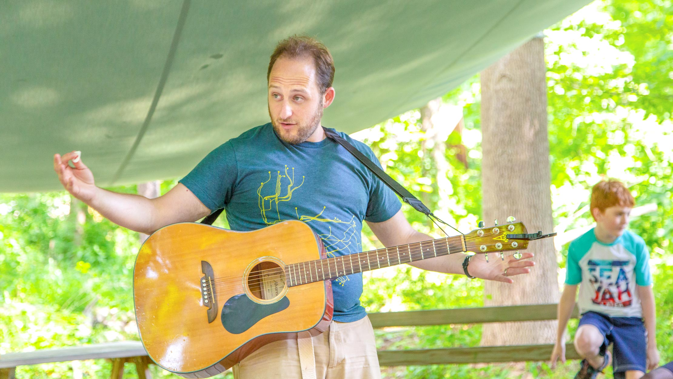 Counselor storytelling with guitar