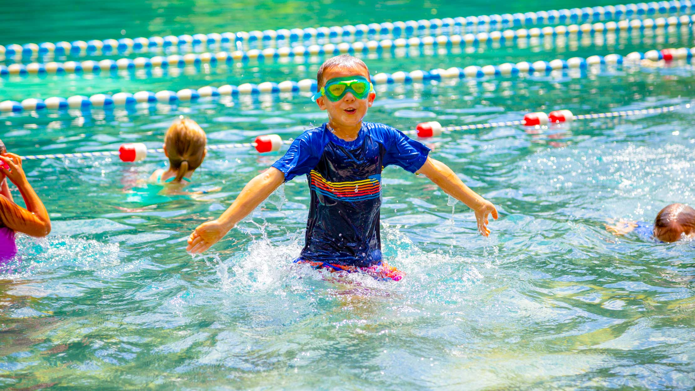 Boy in the pool with goggles