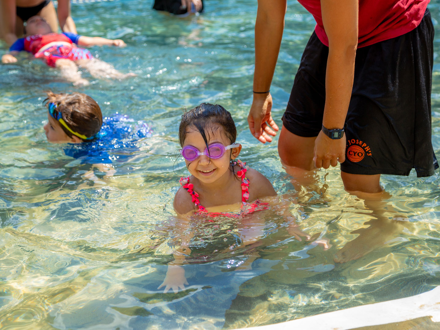 Young camper swimming