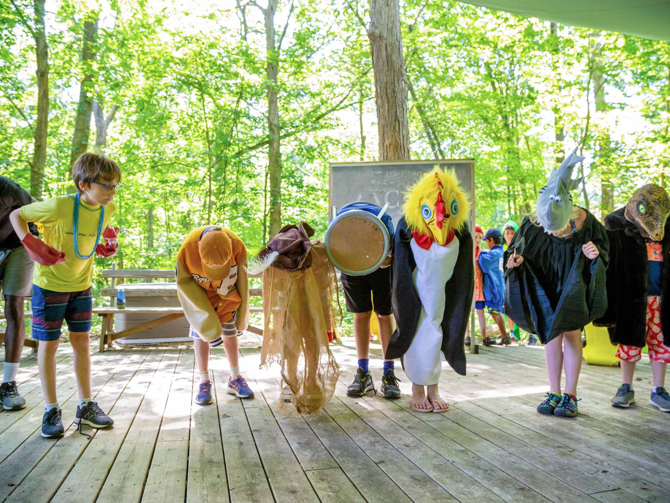 Campers bowing after a performance