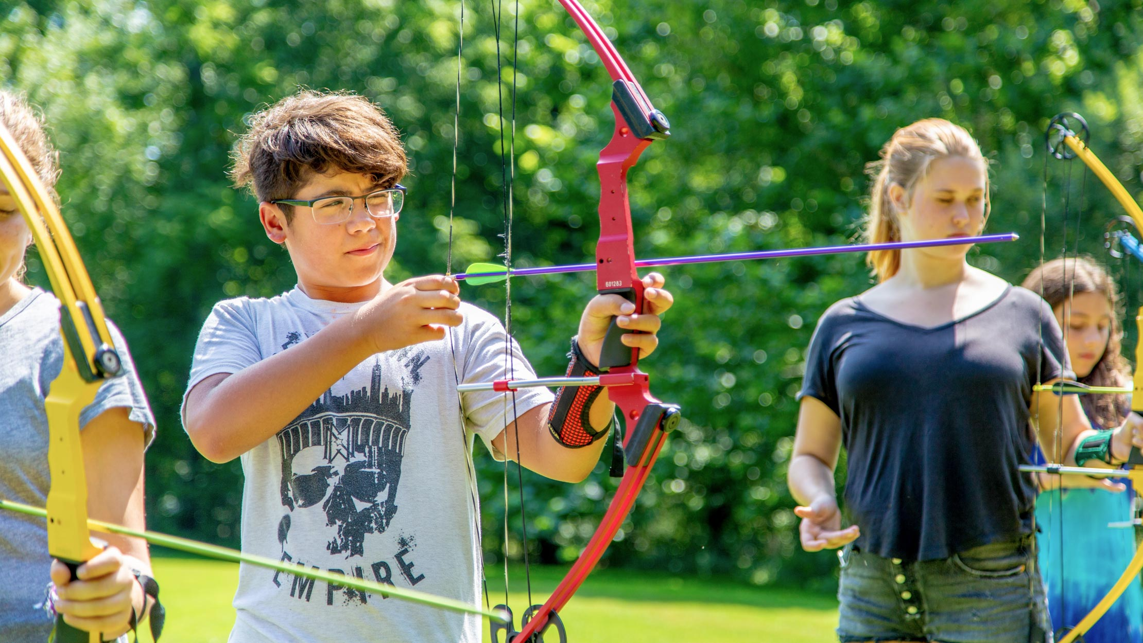 Campers doing archery