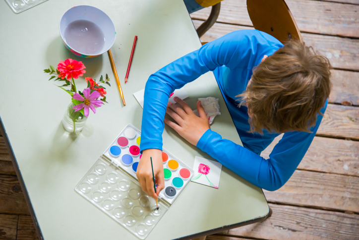 Camper using water colors to paint