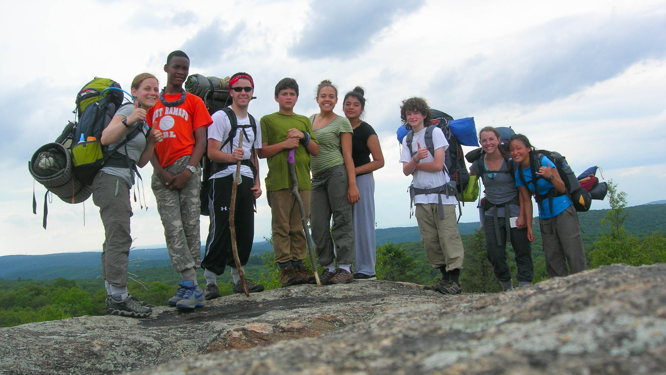 Backpackers on top of a rock
