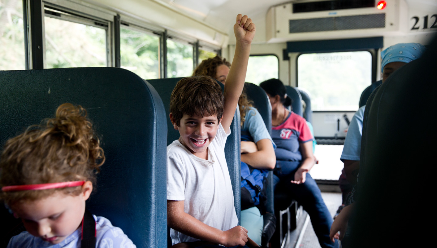Campers excited on the bus