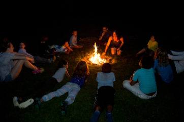 Campers all around a campfire