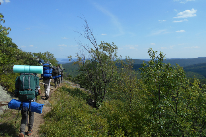Campers backpacking through the mountains
