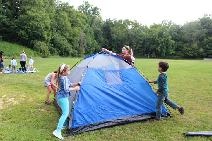 Campers putting up a tent