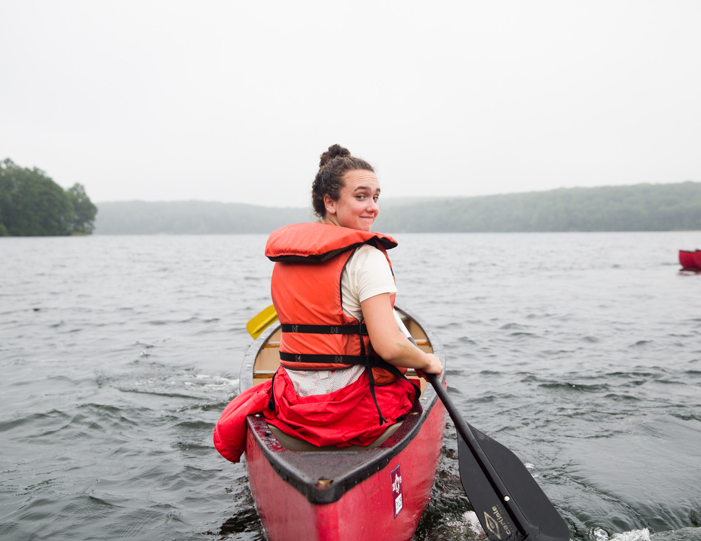 Counselor canoeing in the lake