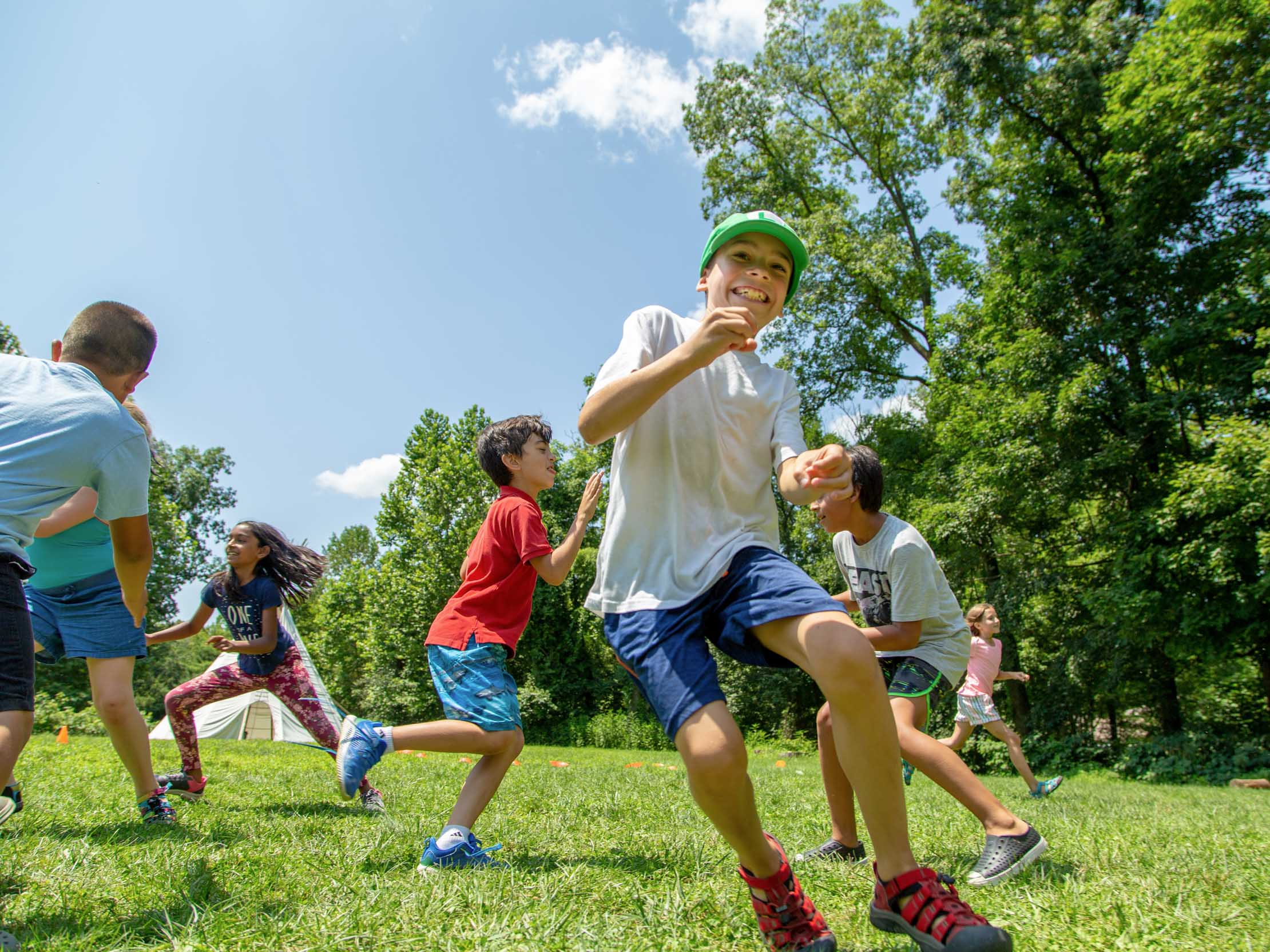 Campers running playing games in the field