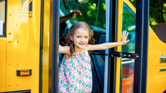 Girl getting off the bus